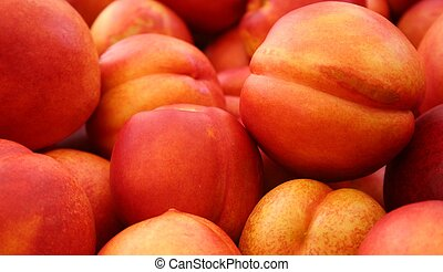 Nectarines - closeup of nectarines on display at a farmers...