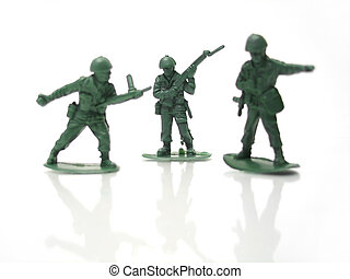 Army men - Three plastic army men figurines in different...