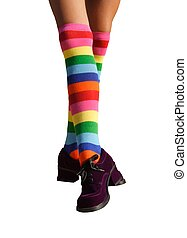 Dancing Legs - Isolated dancing legs in striped knee-hi...