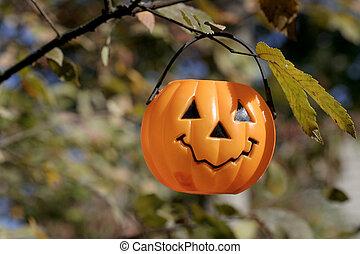 pumpkin hanging2 - childs plastic pumpkin pail hanging on...