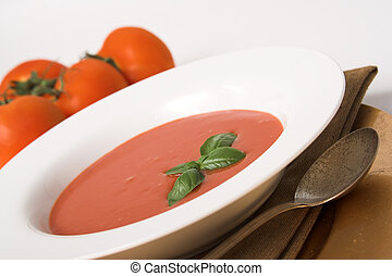 tomato soup - classic tomato soup with a basil leaf