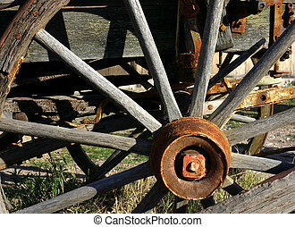 Ancient Wagon Wheel - Old wagon wheel mounted on a wagon on...