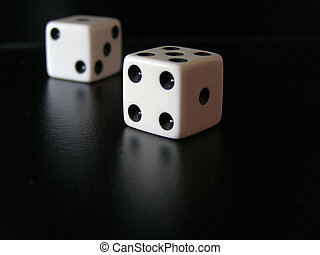 Dice - Shot of dice on refelctive black surface