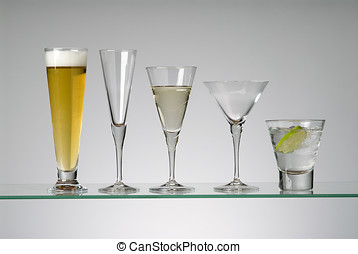 glassware - assorted cocktail glasses, three with drinks in...