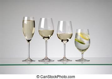 wine glasses - assorted white wine glasses,three with wine...