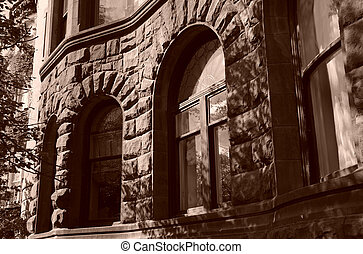 Curving curved windows - arched windows in curved stone...