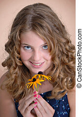 Girl with Flowers - Pretty girl smiling, holding Black-eyed...