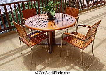 Veranda furniture - Wooden table and chairs on a veranda
