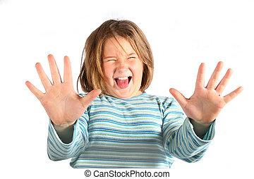 having fun - young girl making a funny face at camera