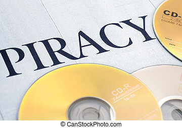 cd and word of piracy, concept of illegal copy