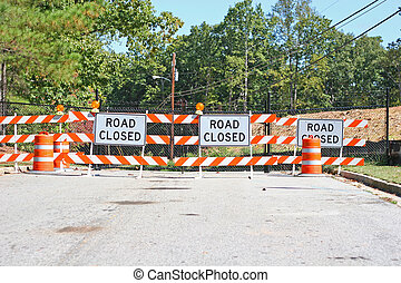 Road Closed 5 - Street barricaded with road closed signs and...