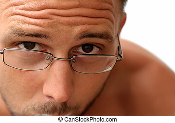 Man Looking - Man with glasses looking curiously at...