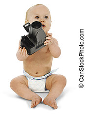 Baby Photographer - Baby with digital camera. Sitting in...