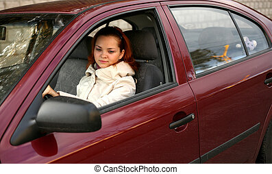 Behind a rudder - The young girl in the red automobile