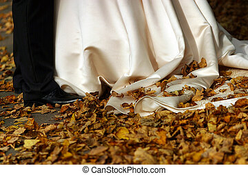 Autumn wedding - The image of legs of the bride and the...