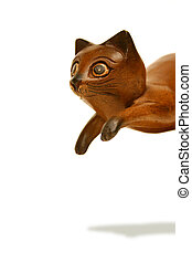 Perpetual pounce - Wooden cat statue caught in a playful...