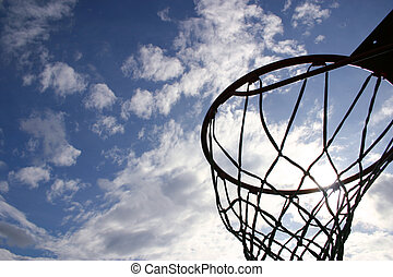 Nuthin but net - Silhouette of a basketball hoop against a...