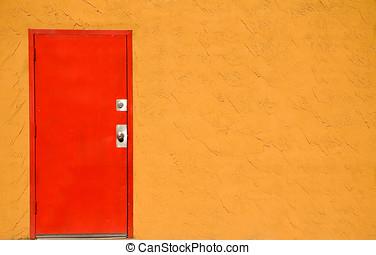 Red door - Red steel door in a orange stucco wall.