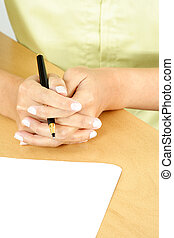 Businesswoman - A businesswoman holding a pen ready to write...