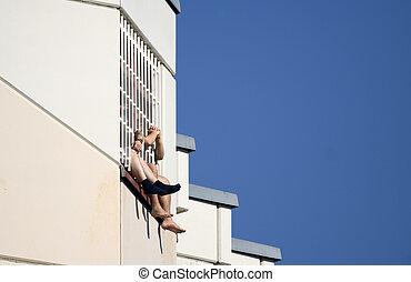 people jail prison - In the summer heat two prisoners behind...
