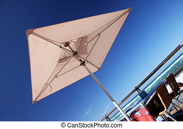 Beachfront Umbrella - Beachfront parasol with table and blue...