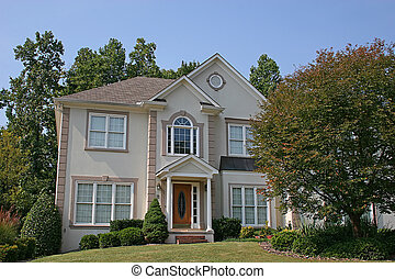 Stucco House 3 - Nice stucco house with greren lawn against...