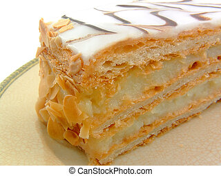 Dessert - A slice of cream filled torte on a plate