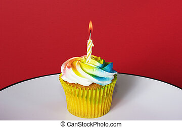 Celebration Cupcake - Delight colored cupcake with candle