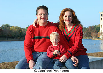 Happy family - Family in casual photo beside lake
