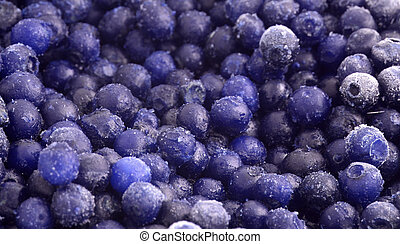 frozen blueberries - a pile of small frozen wild blueberries