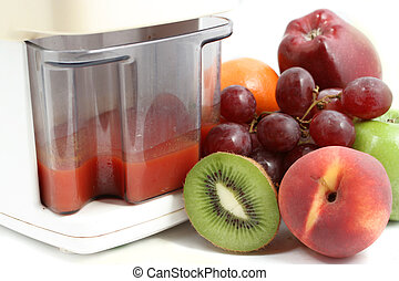 fruit juicer - variety of fruit and freshly made juice in...