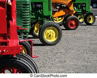 Colorful Tractors - Colorful vintage farm tractors lined up...