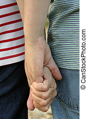 Generation Hands - Clasped hands of grandmother and teenage...