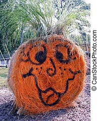 Haybale Pumpkin - A pumpkin made out of a haybale.