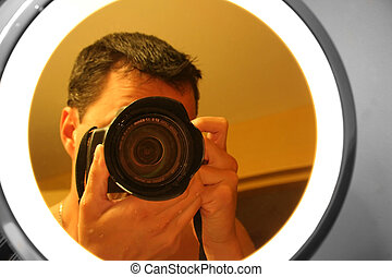 Photographer in the Mirror - Reflection of Photographer in...