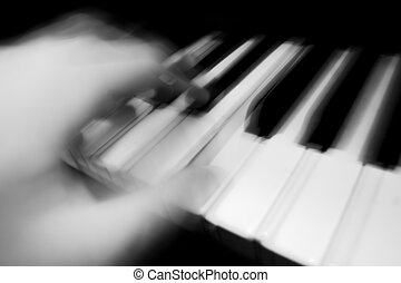 Piano being played - A piano being played, conveying a sense...