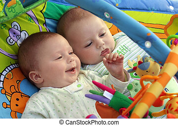 Twin baby boys - Two baby boys twin brothers playing...