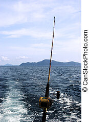 Fishing rod cast out to see from the back of a boat