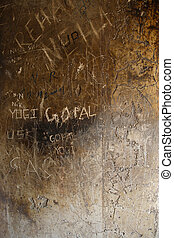 Vandalized wall - A wall of a temple in india that has had...