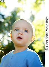 Little boy outdoors - Adorable little boy playing in a park