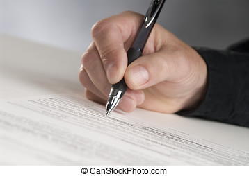 sign here - man\\\'s hand holding a pen signing papers