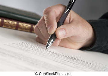 paperwork - man\\\'s hand holding a pen signing a paper,...