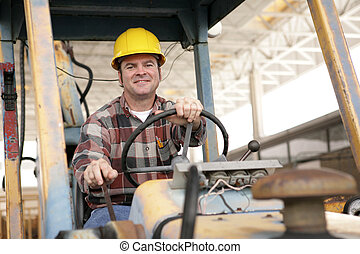 On The Job - A handsome construction worker driving a...