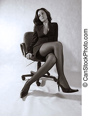 Business woman - The business woman in office armchair....