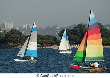 Sailing in Mission Bay 2 - Two yachts and a catamaran are...