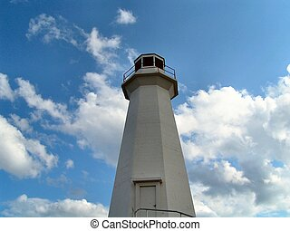lighthouse scenic - a lighthouse in front of clouds
