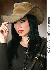 Beautiful cowgirl wearing hat - Cowgirl in casual clothing...