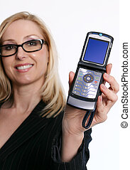 Famale holding an open flip phone - A cheerful woman holding...