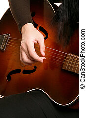 Playing strumming a guitar - Hands melodically strumming an...