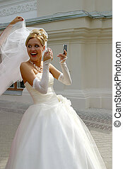 Correct a make-up - The cheerful bride with a mirror